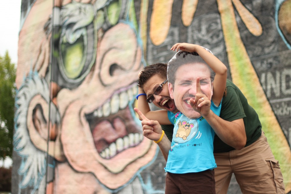 Mister C and Bob hanging out in front of the graffiti wall